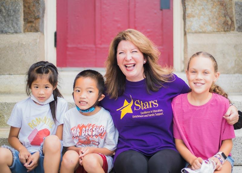 Atlantic Afterschool program teacher with 3 students