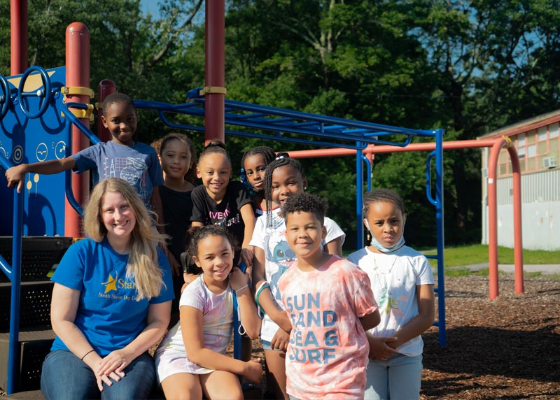 Group of afterschool kids on playground equipment