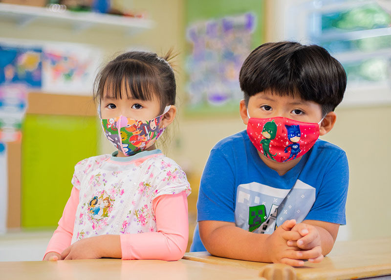two Asian preschoolers with masks